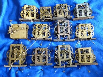 TWELVE (12) antique clock movements