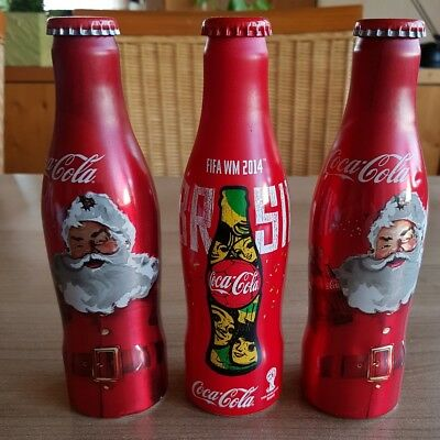 very nice coca cola alu bottles football and x-mas from austria. All full