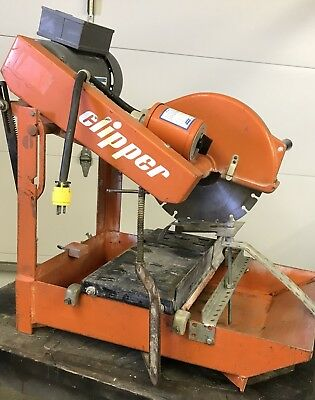 "Used  Norton Clipper Masonry Saw with 3 14"" blades"