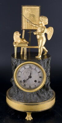 Decor Art. France. Bronze Mantel clock with a figurine of an angel painting.