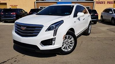 2017 Cadillac XT5 Base 2017 Cadillac XT5 Pearl white on tan leather like new in and out rebuilt title !