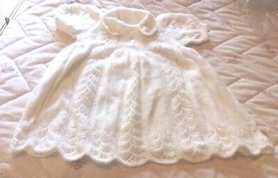 Hand knitted baby's dress - white
