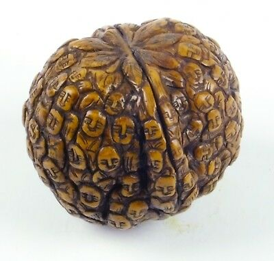 Nut of 100 faces-hand carved walnut with little faces on it early1800's