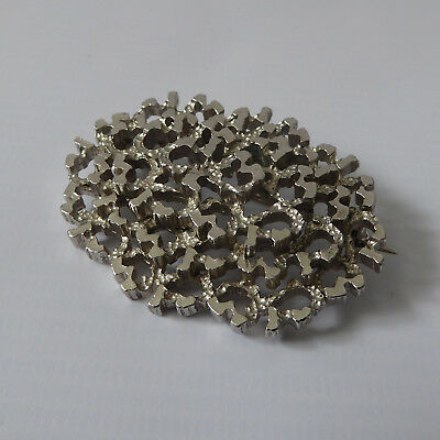 Silver tone Brutalist brooch/pin. Modernist 70s textured/layered. Oval Sphinx?