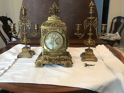 Antique japy freres brass clock with pair of candleabras