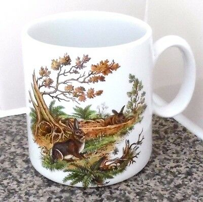 Holkham Pottery Mug Cup 2 Rabbits In A Woodland Scene