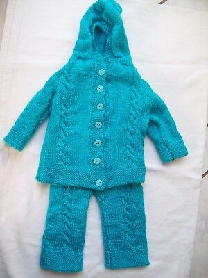 Hand Knit Baby's Romper Suit. Aqua/green. Size  6 + Months. Very Warm