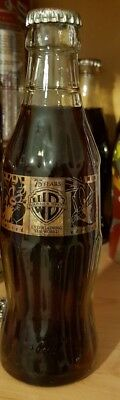 Coca Cola ACL glass bottle from germany. Gold Letters Warner Bros 75 years rare