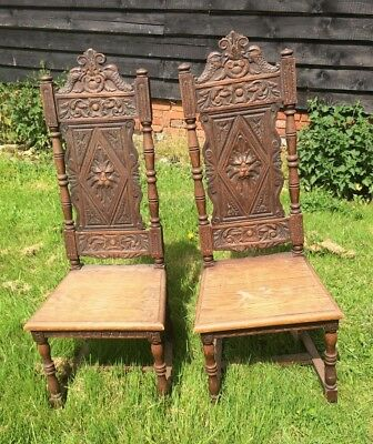 2 Old Oak Hall Chairs Carved with Lions Heads and Fishes