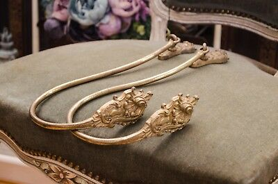 Pair of antique French ormolu ornate curtain tie backs.