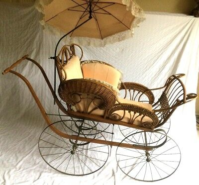 "Antique 55""LONG WICKER BABY CARRIAGE w/ PARASOL. SEARS 1901 catalog."