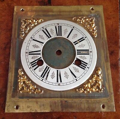A Brass And Steel Square Clock Dial