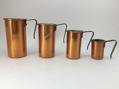 (4) Vintage Copper plated Measuring Cups- Brass Handles.