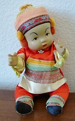 Vintage Asian, probably Chinese, baby or toddler doll, hand painted with pigtail
