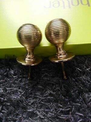 A Pair Of Round Brass Handles with curcular detailling.