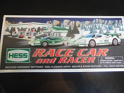 2009 race car and racer -flashing lights and sound features NEW IN BOX NEVER OPE