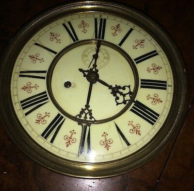 An Eight Inch Fleur De Leys Cream Porcelain Dial Vienna Clock Movement