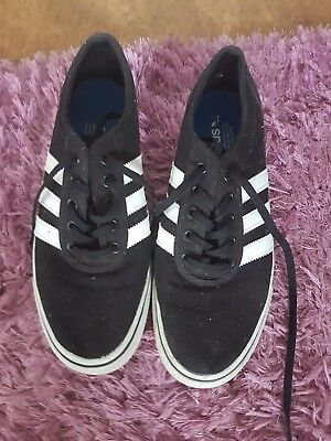 Adidas 3 stripes black Unisex shoes labeled a size 9 Near new