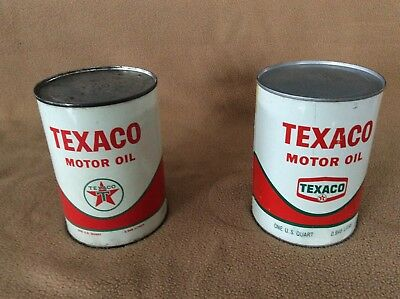 Two full vintage Texaco quart oil cans, dated 6-65 and 11-68 in good condition
