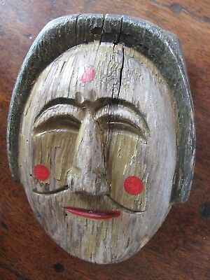 An antique/vintage wooden carved & painted mask/wall plaque