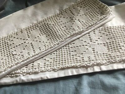 Pair of vintage thick cotton twill pillowcases with a heavy French lace edge
