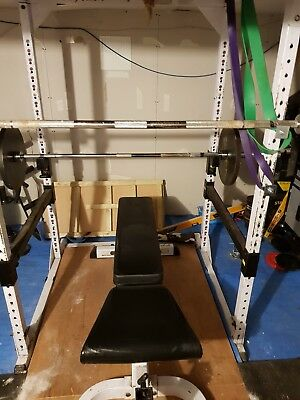 power rack, bench, bars and Olympic weights