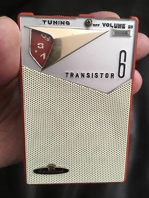 REVERSE PAINT coral color FLEETWOOD transistor radio WORKS no cracks/chips NICE!