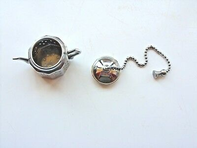 silver plated tea strainer shape of a teapot made in england VGC