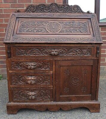 Victorian antique solid carved oak Green Man gothic cat mask bureau writing desk