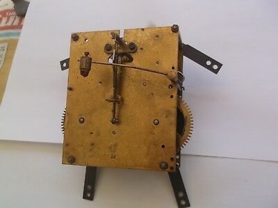 UM  MECHANISM  FROM AN OLD  MANTLE CLOCK GOOD working order