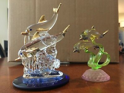 Two Glass dolphin figurines with gold accents