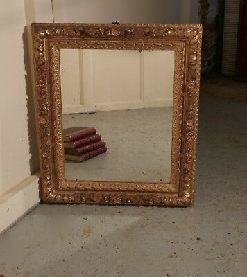 Early 19th Century Carved Wood Gilt Rococo Wall Mirror