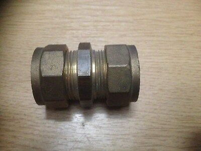 "Brass Compression Fitting 3/8"" x 3/8"" Straight Coupling with Copper Olives."