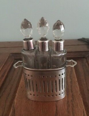 Three Shaped Silver Topped Perfume Bottles In Fitted Silver Frame 1923.