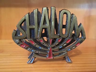 """Brass letter rack with the words """"Shalom"""" the letter rack has coloured jewels"""