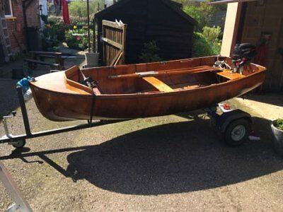 A beautiful 1950s varnished wooden 10ft dinghy
