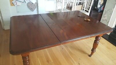 Victorian solid mahogany wind out extendable dining table with ornate legs