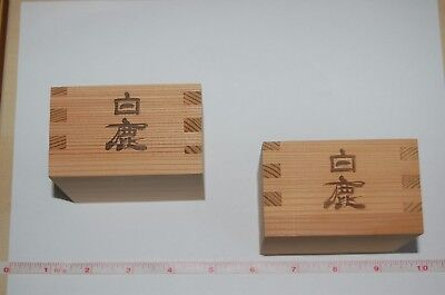 Two wooden japanese saki cups boxes