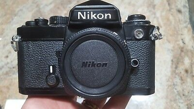 Nikon FE 35mm SLR Camera Body Black w/ two focusing screens