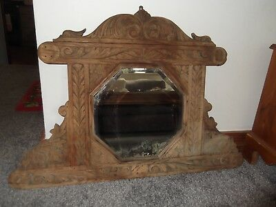Antique distressed mirror in Carved Frame