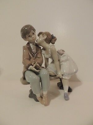 Lladro figurine: Young Boy and Girl Sitting on a Bench Together
