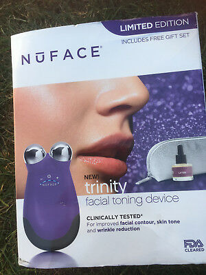 nu face trinity facial toning device purple with elle device attachment