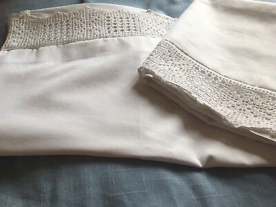 Pair of white vintage cotton pillowcases with a handmade lace edge
