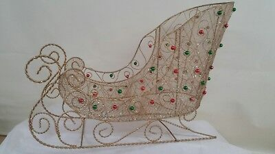 Santa's sleigh decorative gold wire red and green bulbs.