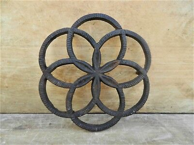 Antique Cast Iron Hearth Trivet Footed Poinsettia Flower & Circles Design