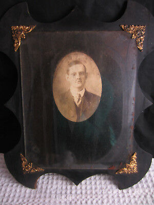 antique man studio portrait creepy eye early 20th century old brass wood frame