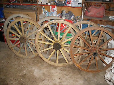 Ancient wooden cart wheels. 700 - 900mm diameter