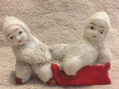 Vintage/Antique Miniature Snow Babies with sled Japan 2.5 ""