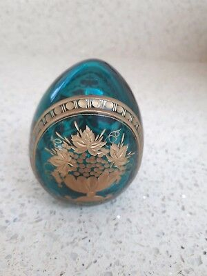 Green glass egg engraved with gold decoration