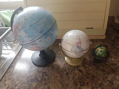 3 unusual world globes ones spins on axis and the small 1 is a pencil sharpener